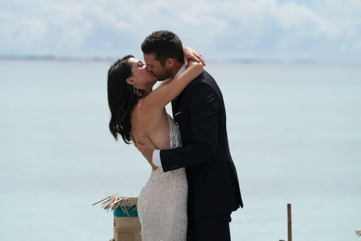Becca and Garrett kiss during the final rose ceremony in the Maldives.