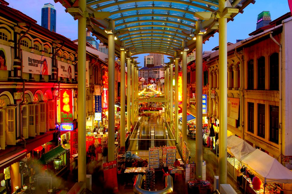 At the end of the book, Nick suggests Rachel, Kerry and Peik Lin go to Chinatown's food market on Smith Street in Singapore,