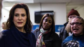 DETROIT, MI  - DECEMBER 19: Gretchen Whitmer listens to longtime friend, Bill Baldridge at the United Precinct Delegates office on W McNichols Rd in Detroit, Michigan on December 19, 2017. (Photo by Ali Lapetina for The Washington Post via Getty Images)