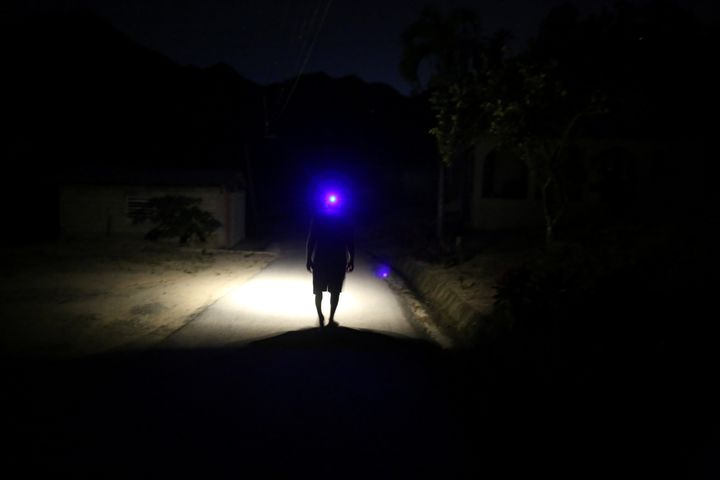Jose Alvarez, 60, using a headlamp while walking in the dark in Juyaya, Puerto Rico, in May.