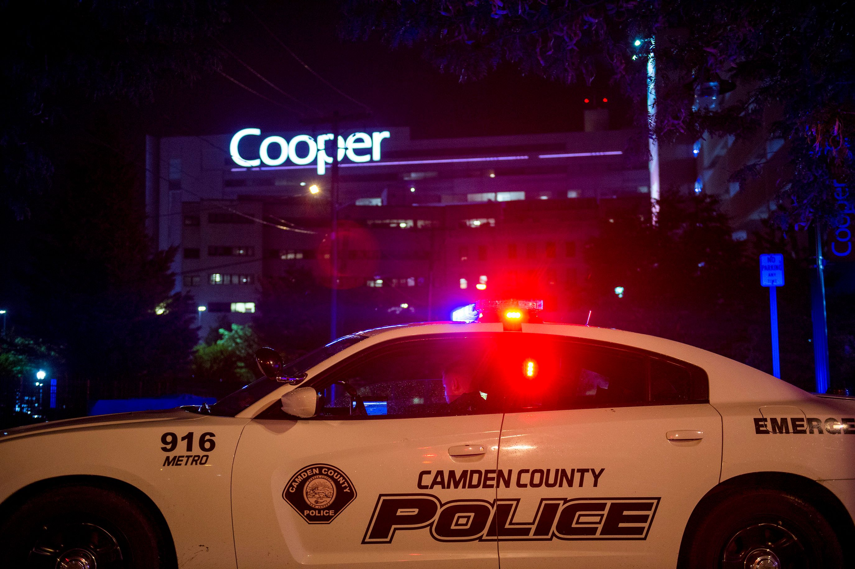 An officer is posted by Copper hospital following a shooting that left two detectives wounded in Camden NJ Tuesday Aug 7 2018 Camden County Police Chief J Scott Thomson said at least one suspect opened fire on the plainclothes detectives Tuesday night in Camden located just across the Delaware River from Philadelphia