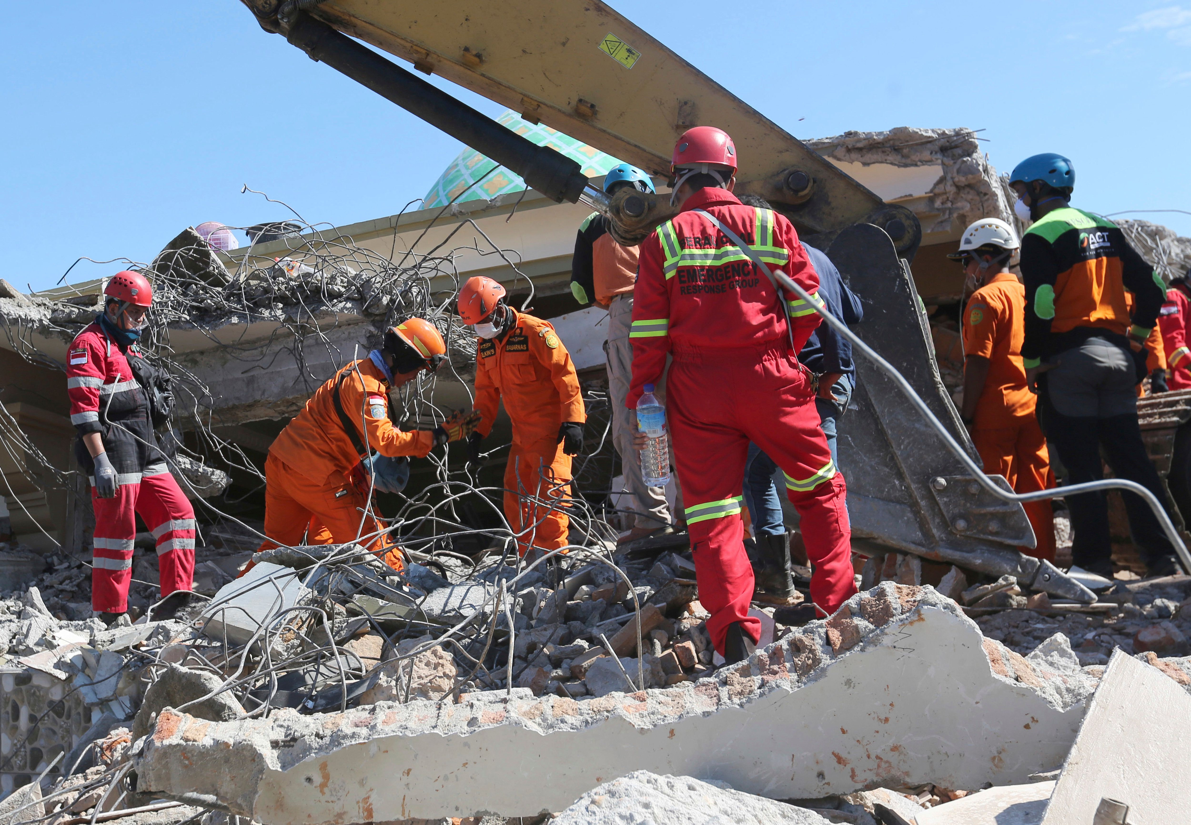 Rescuer teams continue to search for victims in the collapsed Jamiul Jamaah Mosque in Bangsal, North Lombok, Indonesia, Wednesday, Aug. 8, 2018. The north of Lombok was devastated by the powerful earthquake that struck Sunday night, damaging thousands of buildings and killing a large number of people. Rescuers were still struggling to reach all of the affected areas and authorities expect the death toll to rise. (AP Photo/Tatan Syuflana)ll to rise. (AP Photo/Tatan Syuflana)