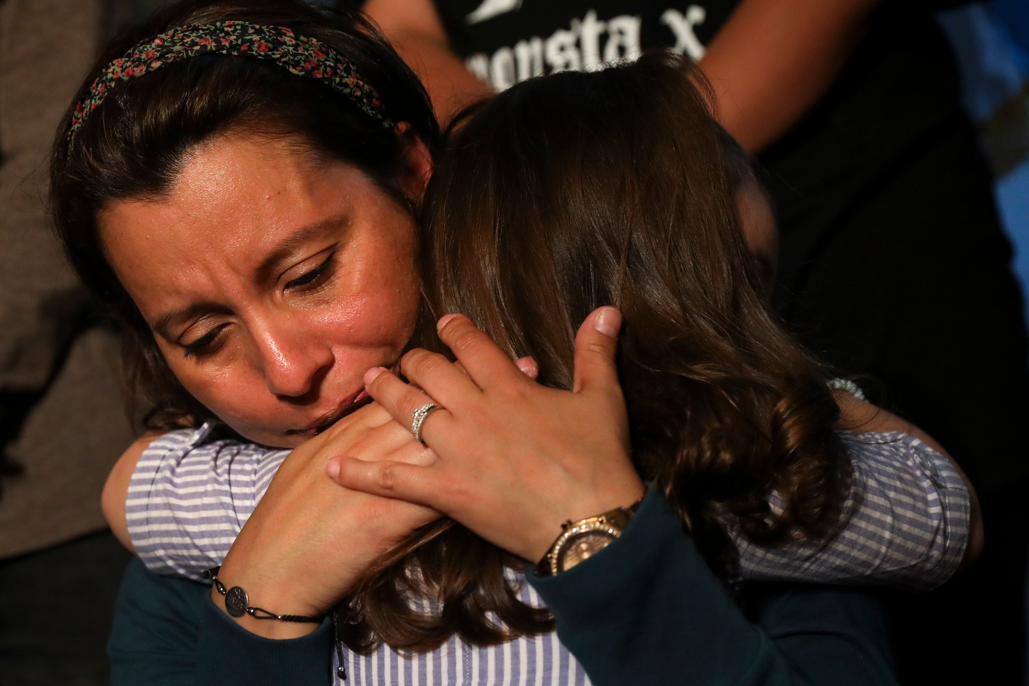 NEW YORK, NY - JULY 23:  Sandra Chica, wife of Pablo Villavicencio, hugs her daughter Luciana during an advocacy rally and press conference in support of Pablo Villavicencio, who was arrested and detained in early June by Immigration and Customs Enforcement (ICE) after making a catering delivery to Fort Hamilton Army Base in Brooklyn, July 23, 2018 at City Hall in New York City. Supporters of Villavicencio plan to rally in his support outside of the federal courthouse during his court hearing on Tuesday morning. (Photo by Drew Angerer/Getty Images)