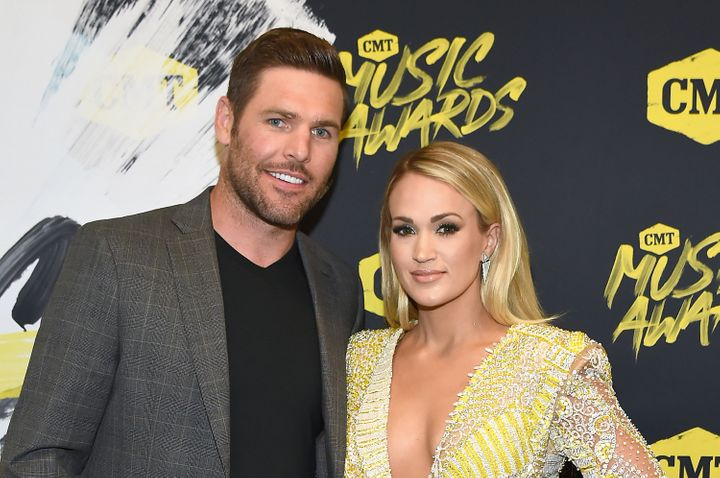Mike Fisher and Carrie Underwood attend the 2018 CMT Music Awards together on June 6.