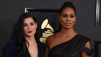 Trace Lysette (L) and Laverne Cox  arrives for the 59th Grammy Awards on February 12, 2017, in Los Angeles, California.  / AFP / Mark RALSTON        (Photo credit should read MARK RALSTON/AFP/Getty Images)