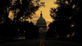 The sun sets behind the U.S. Capitol in Washington, U.S., August 7, 2018.     REUTERS/Brian Snyder