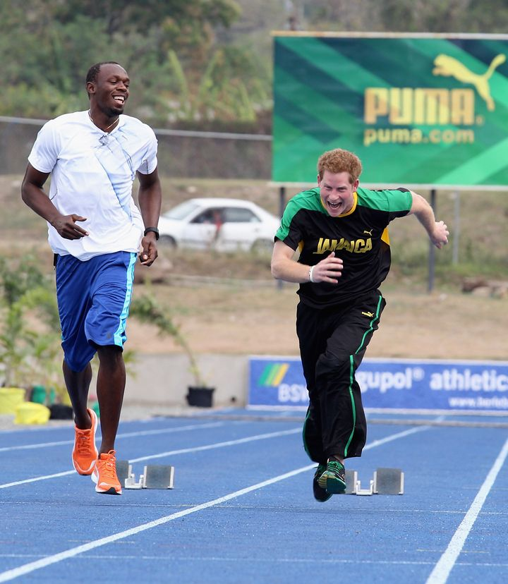Harry races Usain Bolt at the University of the West Indies on March 6, 2012, in Kingston, Jamaica.