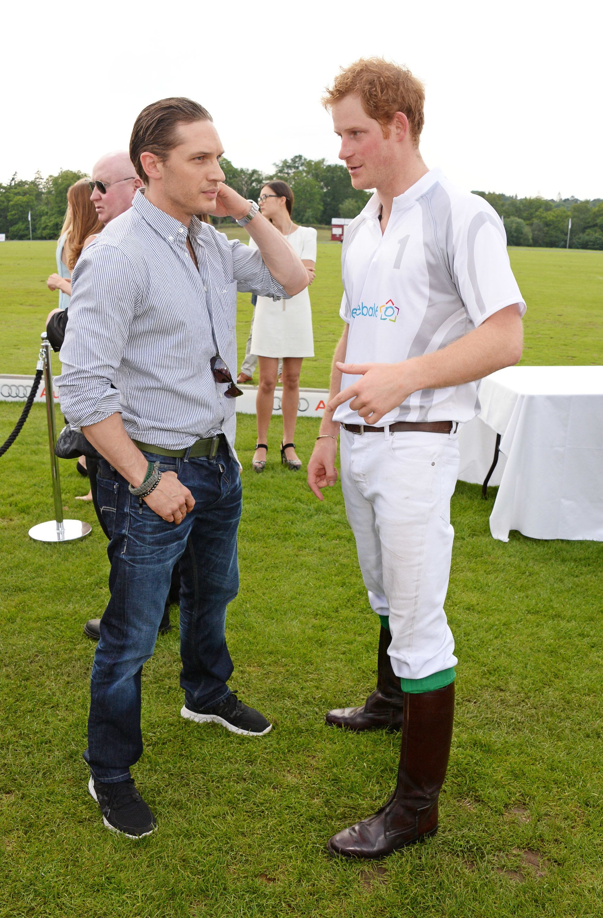 Tom Hardy and Prince Harry chat at the Audi Polo Challenge on June 1, 2014, in Ascot, England.