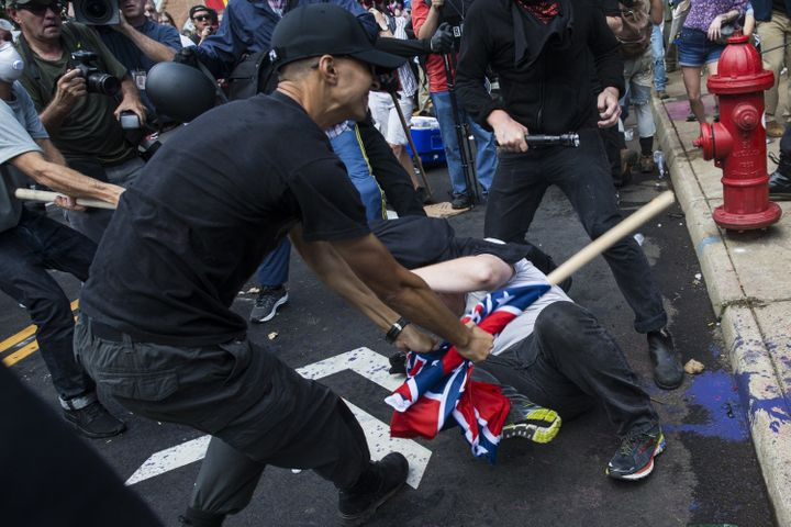 "A white supremacist beats a counter-protester at the Charlottesville ""Unite the Right"" rally in August 2017. ProPublica <a hr"