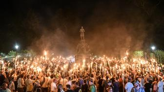 White nationalists participate in a torch-lit march on the grounds of the University of Virginia ahead of the Unite the Right Rally in Charlottesville, Virginia on August 11, 2017. Picture taken August 11, 2017.  REUTERS/Stephanie Keith