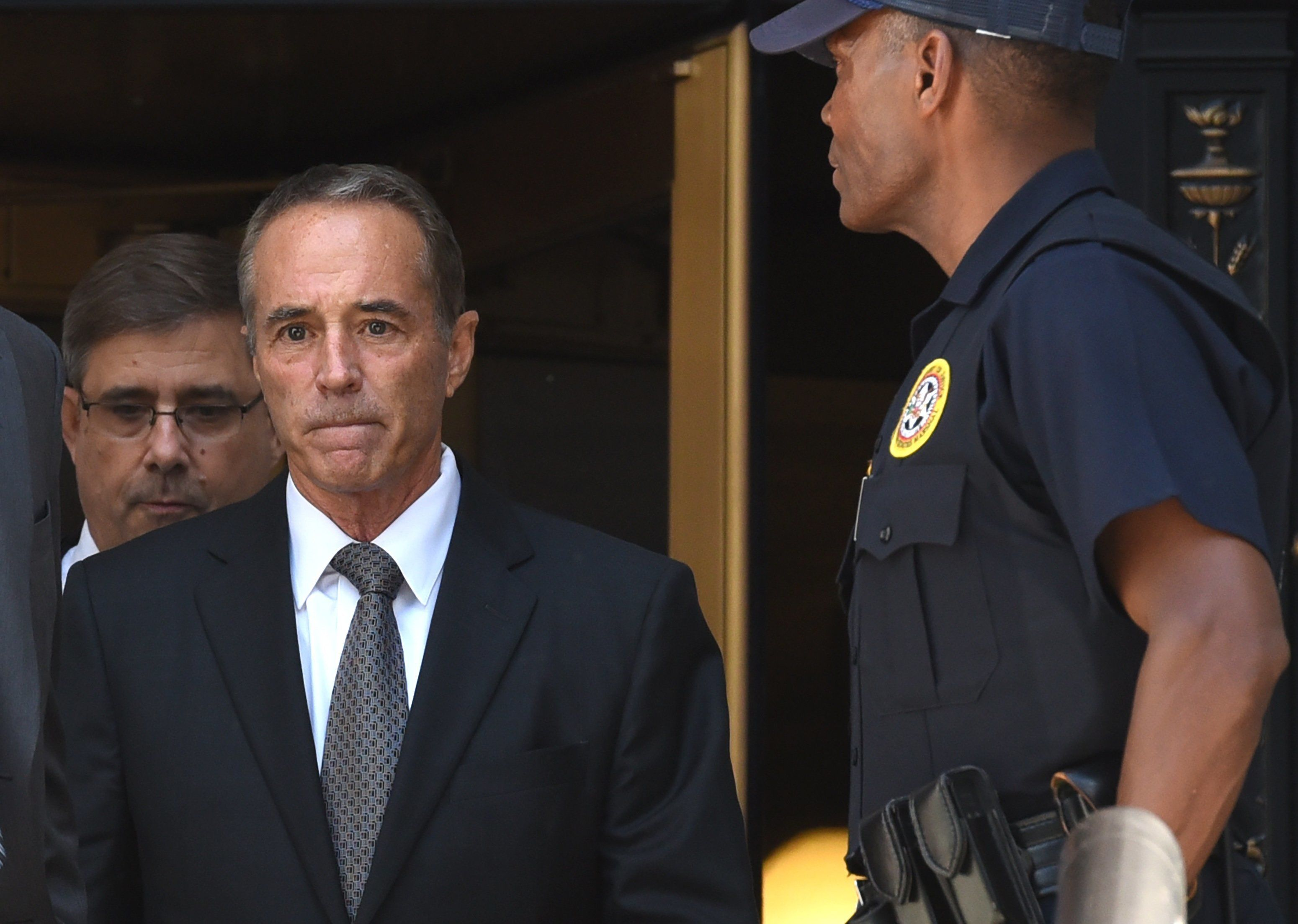 US Representative Chris Collins (L), a Republican from the of the 27th Congressional District of New York, leaves US Federal Court in New York on August 8, 2018 after being indicted on insider trading - Collins, one of the first US lawmakers to declare support for Donald Trump's presidential candidacy, was indicted by federal prosecutors Wednesday on charges of securities fraud connected to an alleged insider trading scheme. (Photo by TIMOTHY A. CLARY / AFP)        (Photo credit should read TIMOTHY A. CLARY/AFP/Getty Images)
