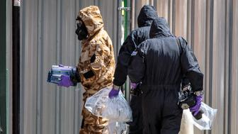 SALISBURY, ENGLAND - JULY 06: Emergency workers in protective suits search around John Baker House Sanctuary Supported Living after a major incident was declared when a man and woman were exposed to the Novichok nerve agent on July 6, 2018 in Salisbury, England. The couple, named locally as Dawn Sturgess 44, and Charlie Rowley, 45 were taken to Salisbury District Hospital on Saturday and remain there in a critical condition. In March, Russian former spy Sergei Skripal and his 33-year-old daughter Yulia were poisoned with the Russian-made Novichok in the town of Salisbury. British Prime Minister Theresa May has accused Russia of being behind the attack on the former spy and his daughter, expelling 23 Russian diplomats in retaliation.(Photo by Jack Taylor/Getty Images)