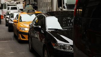 NEW YORK, NY - JULY 30:  Cars drive through afternoon traffic on July 30, 2018 in New York City. After a significant increase in local traffic and a spate of suicides by taxi drivers, New York City is planning to vote on capping ride-sharing services such as Uber and Lyft. The  City Council's move to vote on the measures could come as soon as Aug. 8. If the vote was to succeed, New York City would become the first major U.S. municipality to cap ride-sharing services.  (Photo by Spencer Platt/Getty Images)