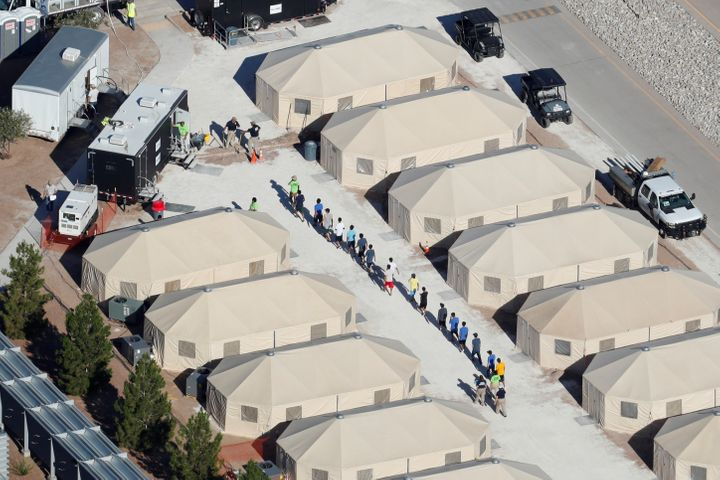 Immigrant children at a tent encampment in Tornillo, Texas, are seen walking single file on June 19.