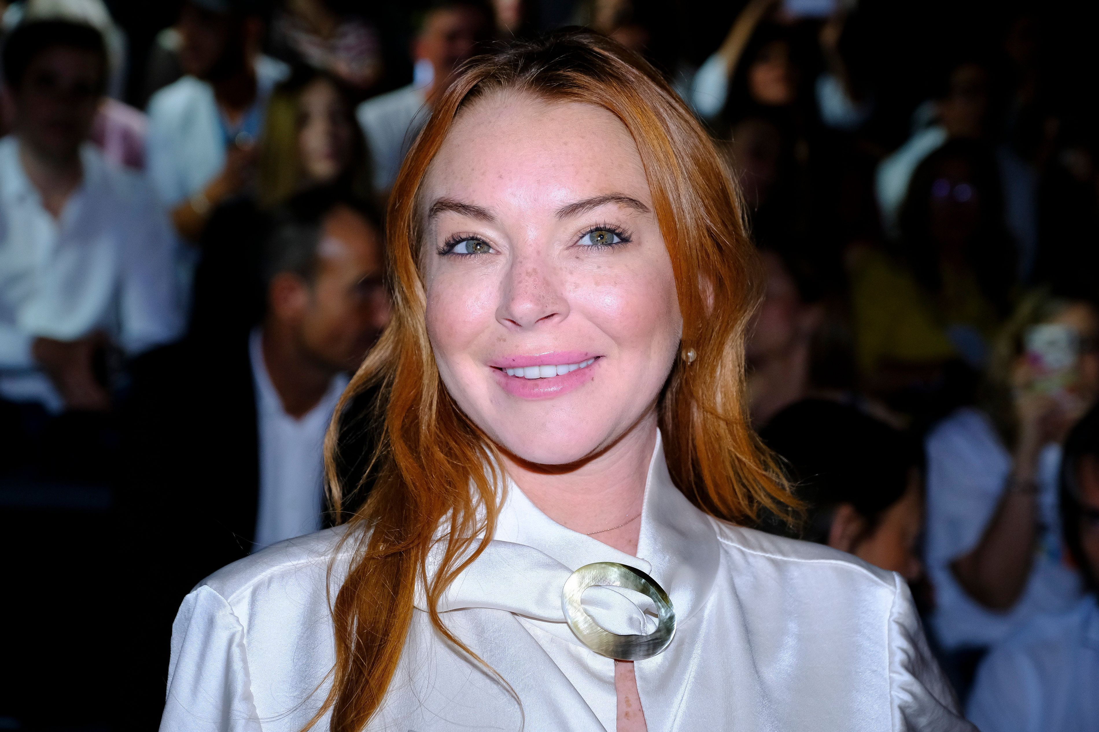 Lindsay Lohan Shown Here At Madrid Fashion Week In  Said Women Should File