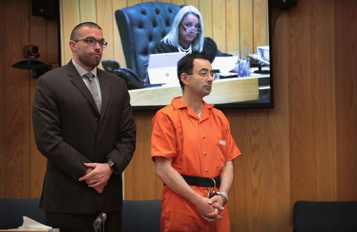 Nassar and former attorney Matt Newburg stand during his sentence hearing with Judge Janice Cunningham in Eaton County Circuit Court on Feb. 5, 2018, in Charlotte, Michigan.