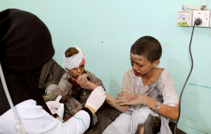 A doctor treats children injured by an airstrike in Saada, Yemen August 9, 2018.