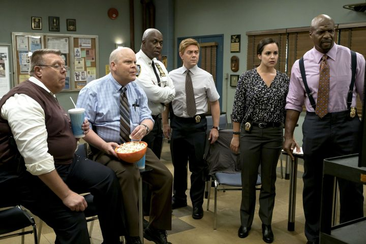 "The cast of ""Brooklyn Nine-Nine"" shooting an episode."