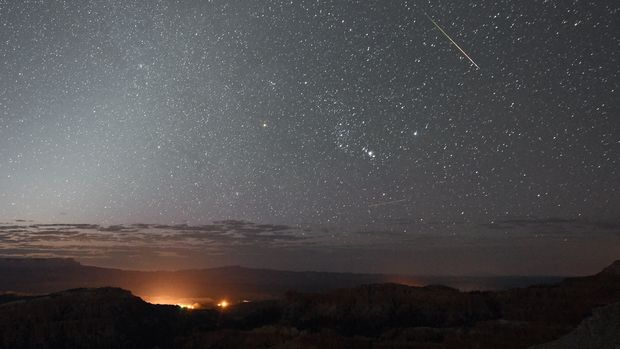 BRYCE CANYON NATIONAL PARK, UT - AUGUST 12:  A Perseid meteor streaks across the sky above Inspiration Point early on August 12, 2016 in Bryce Canyon National Park, Utah. The annual display, known as the Perseid shower because the meteors appear to radiate from the constellation Perseus in the northeastern sky, is a result of Earth's orbit passing through debris from the comet Swift-Tuttle.  (Photo by Ethan Miller/Getty Images)