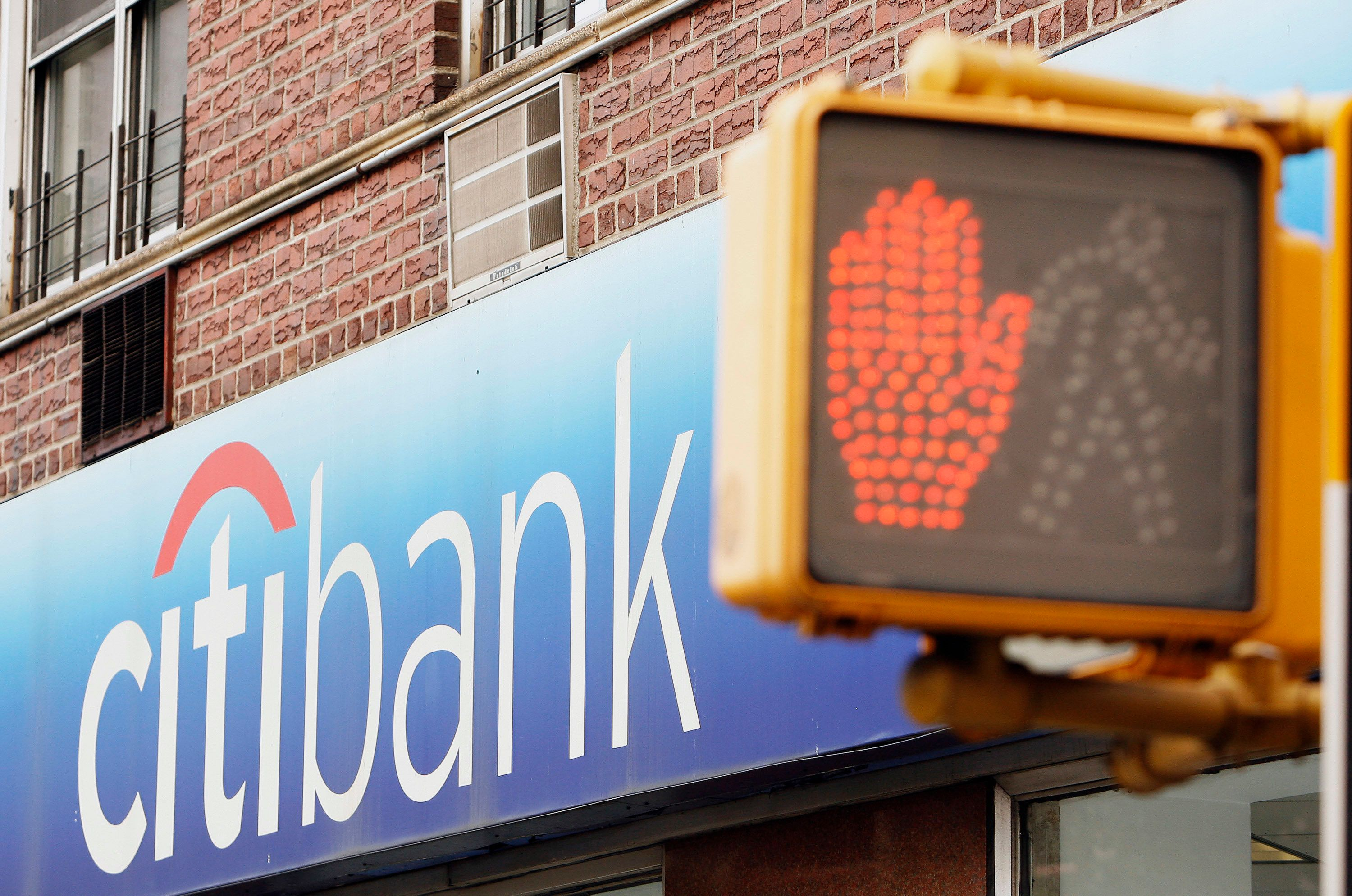 Pedestrian signals can be seen outside of a Citibank branch in New York, October 6, 2008. Citigroup said it is suing Wachovia and Wells Fargo and is seeking more than $60 billion in damages over Wells Fargo's competing bid for Wachovia. REUTERS/Lucas Jackson (UNITED STATES)