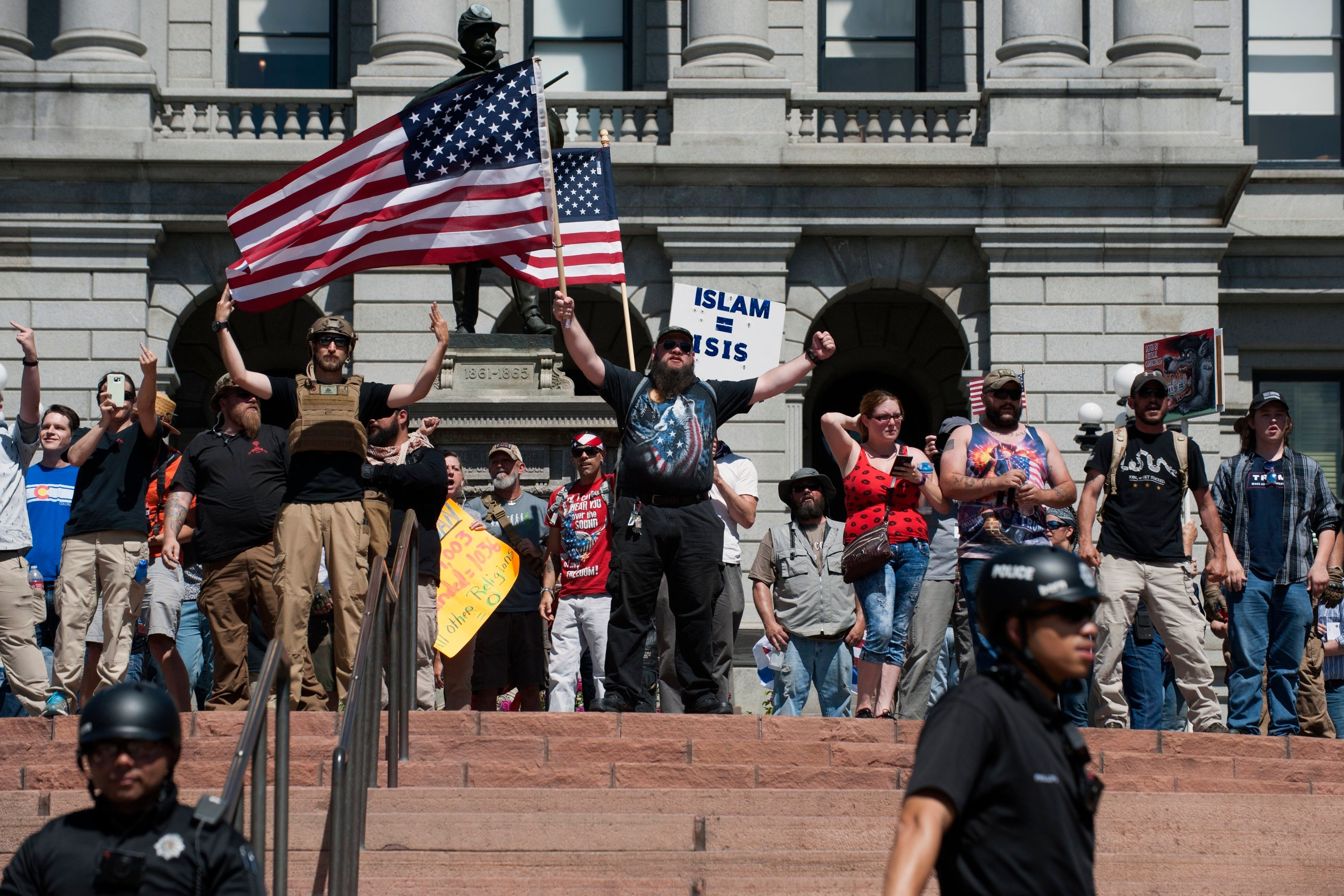 Right-wing demonstrators taunt counter-demonstrators during the Denver March Against Sharia Law in Denver, Colorado on June 10, 2017. The march was supported by two right-wing groups, The Proud Boys, and Bikers Against Radical Islam. Police kept the counter protestors separated during the rally which was held in front of the Colorado State Capital. The march was one of many held throughout the U.S. opposing Sharia law, and was viewed by many as promoting both Islamophobia and racism. / AFP PHOTO / Jason Connolly        (Photo credit should read JASON CONNOLLY/AFP/Getty Images)