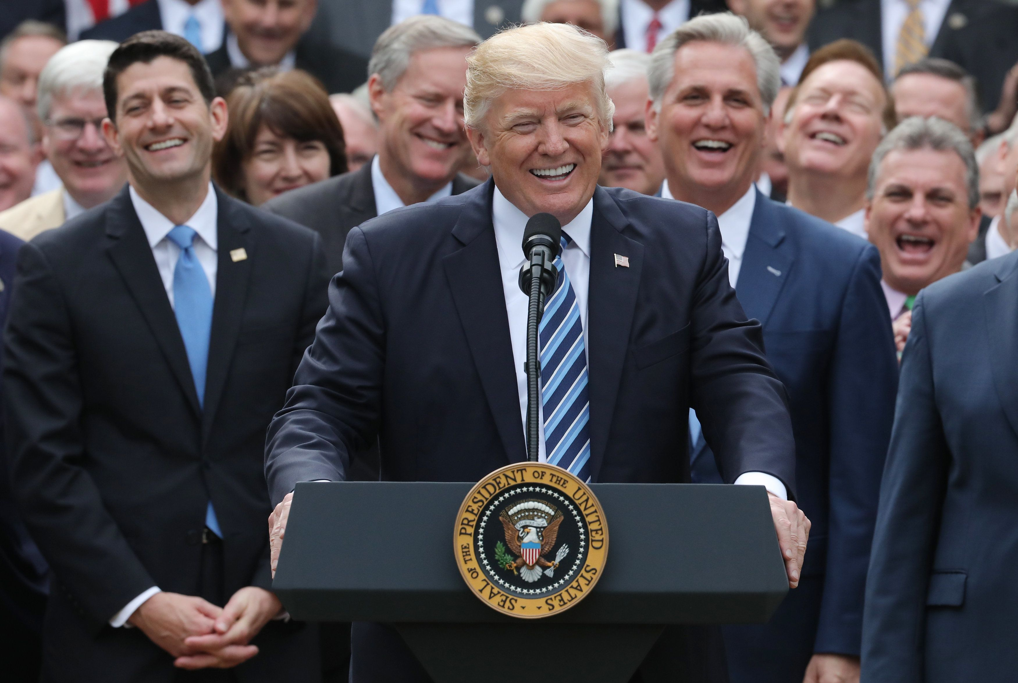 U.S. President Donald Trump (C) celebrates with Congressional Republicans in the Rose Garden of the White House after the House of Representatives approved the American Healthcare Act, to repeal major parts of Obamacare and replace it with the Republican healthcare plan, in Washington, U.S., May 4, 2017. REUTERS/Carlos Barria  TPX IMAGES OF THE DAY