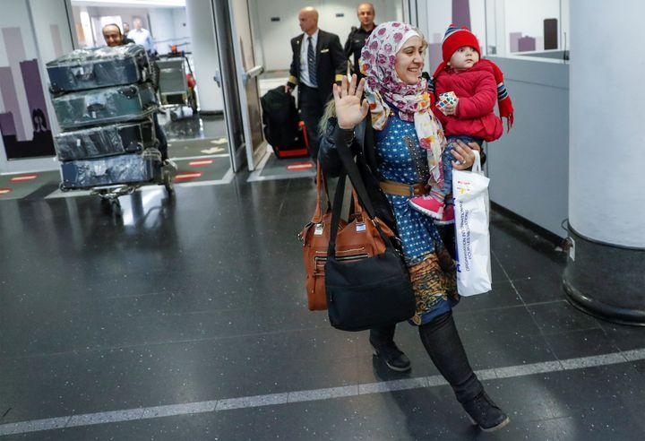 Syrian refugee Baraa Haj Khalaf, her daughter Shams, 1, and husband Abdulmajeed arrive at O'Hare International Airport in Chi