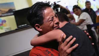 GUATEMALA CITY, GUATEMALA - AUGUST 07:  An emotional father embraces his son for the first time in months on August 7, 2018 in Guatemala City, Guatemala. A group of nine children were flown from New York and reunited with their families, months after U.S. border agents separated them and deported the parents as part of the Trump administration's 'zero tolerance' policy at the border. Some of the children had been held at the Cayuga Center in New York City.  (Photo by John Moore/Getty Images)