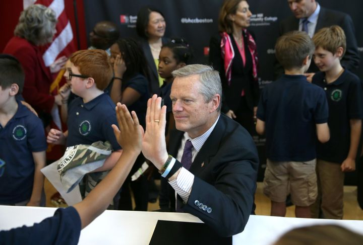 Mass. Gov. Charlie Baker signed a new bill into law on Thursday that will automatically enroll voters when they interact with