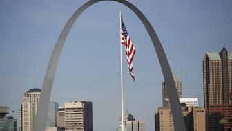 An American flag flies past the Gateway Arch in East St. Louis, Illinois, U.S., on Tuesday, April. 25, 2017. Union Pacific Corp. is scheduled to release earnings figures on April 27. The Gateway Arch is the tallest man-made monument in the Western Hemisphere and Missouri's tallest accessible building. Photographer: Luke Sharrett/Bloomberg via Getty Images