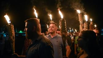 White nationalists participate in a torch-lit march on the grounds of the University of Virginia ahead of the Unite the Right Rally in Charlottesville, Virginia, U.S. August 11, 2017. Picture taken August 11, 2017.  REUTERS/Stephanie Keith