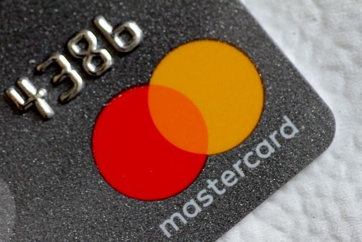 A Mastercard logo is seen on a credit card in this picture illustration August 30, 2017.