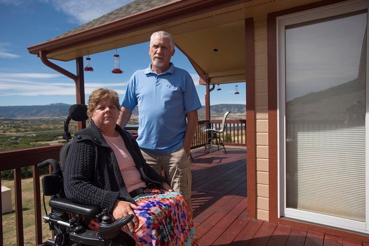 Robbin and Ed Smith at home in Castle Rock, Colo., in 2017. Robbin was paralyzed from the waist down after receiving an epid