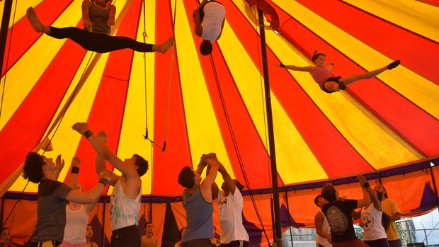 Students from the National Circus School of Puerto Rico and Circus Harmony do a contortion act in the town of Yabucoa