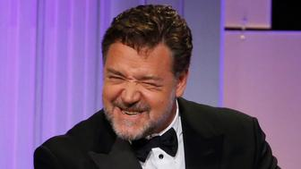 Actor Russell Crowe mimics director Ridley Scott at the 30th annual American Cinematheque Award ceremony in Beverly Hills, California U.S., October 14, 2016.   REUTERS/Mario Anzuoni