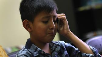 GUATEMALA CITY, GUATEMALA - AUGUST 07:  Abner Raul, 10, speaks with is mother on the phone after he was reunited with his father at the Nuestras Raices immigrant center on a on August 7, 2018 in Guatemala City, Guatemala. A group of nine children were flown from New York and were reunited with their families, months after U.S. border agents separated them and deported their parents as part of the Trump administration's 'zero tolerance' policy at the border. Some of the children had been held at the Cayuga Center in New York City.  (Photo by John Moore/Getty Images)