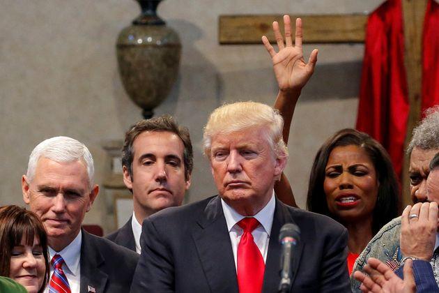 Omarosa Manigault pictured behind Donald Trump in 2016.