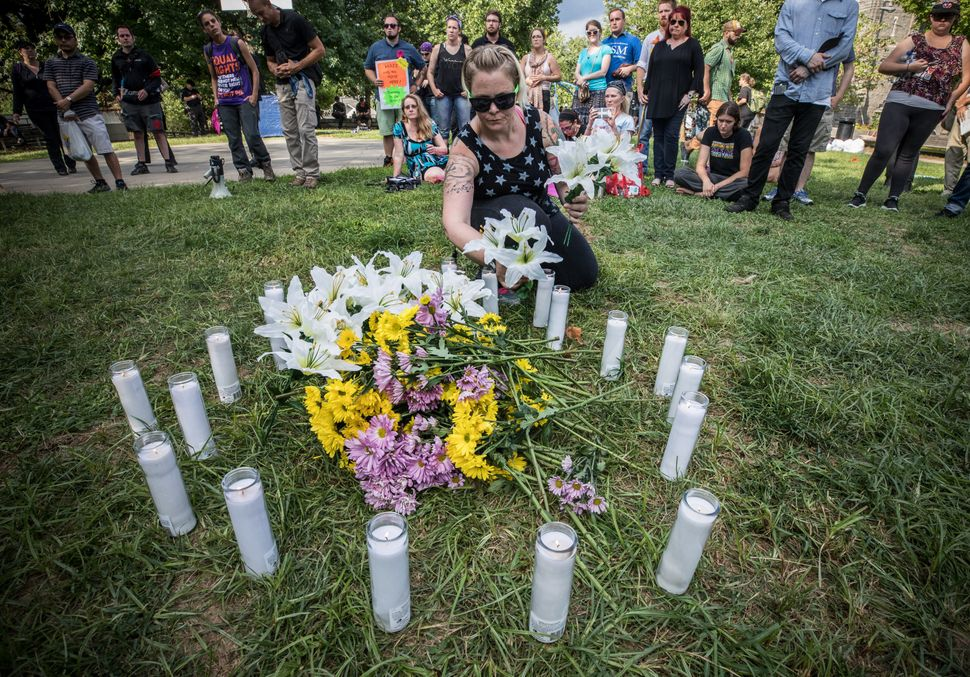 A vigil is held in Charlottesville's McGuffey Park for the victim killed by a car following the Unite the Right rally on Aug.