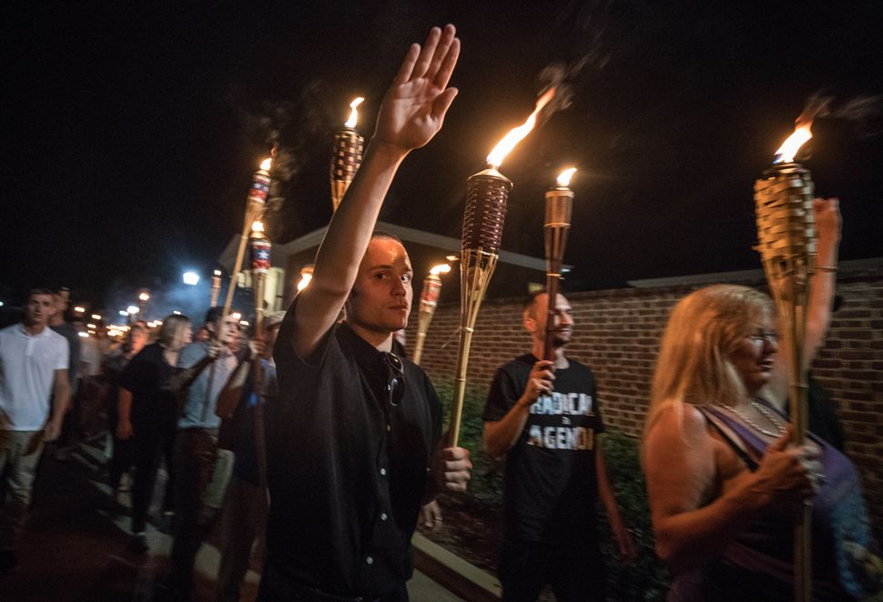 White nationalists and white supremacists carrying torches march through the University of Virginia campus on Aug. 11, 2017.
