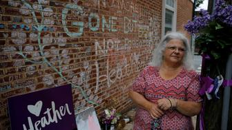 Susan Bro, mother of Heather Heyer, who was killed during the August 2017 white nationalist rally in Charlottesville, stands at the memorial at the site where her daughter was killed in Charlottesville, Virginia, U.S., July 31, 2018. Picture taken July 31, 2018. REUTERS/Brian Snyder