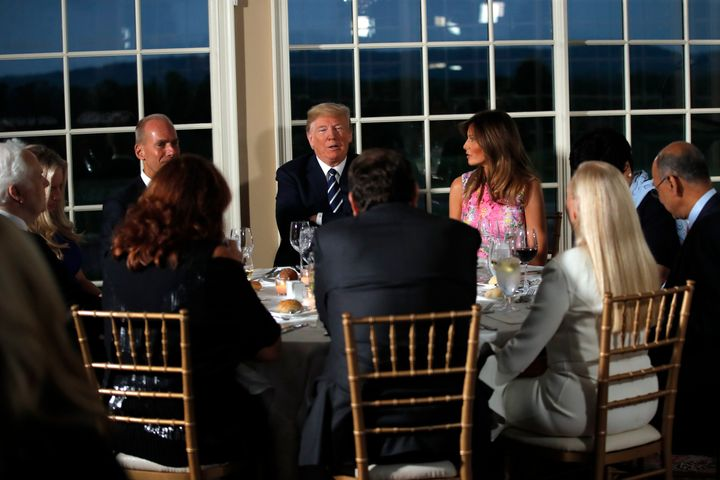 President Donald Trump sits with first lady Melania Trump as he meets with business leaders, Tuesday, Aug. 7, 2018, at Trump