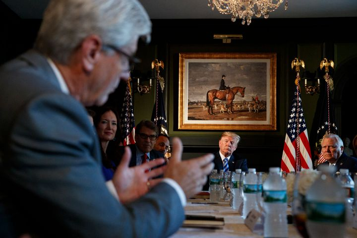 President Donald Trump looks to Mississippi Gov. Phil Bryant, left, as he speaks during a meeting with state leaders about pr