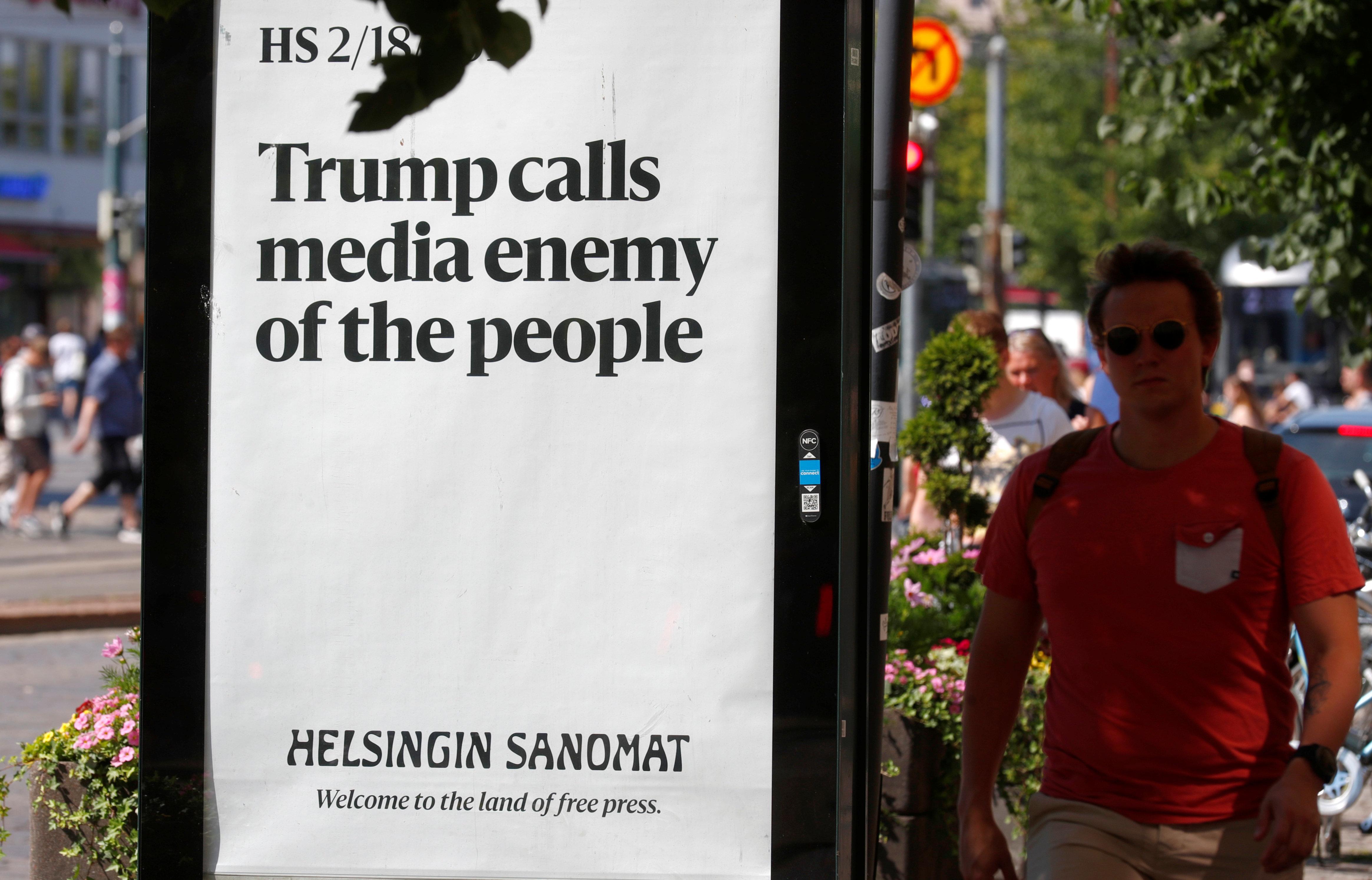 An advert by the Finnish newspaper Helsingin Sanomat is displayed during the U.S. President Donald Trump and Russian President Vladimir Putin summit in Helsinki, Finland July 16, 2018. REUTERS/Ints Kalnins