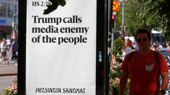 An advert by the Finnish newspaper Helsingin Sanomat is displayed during the U.S. President Donald Trump and Russian President Vladimir Putin summit in Helsinki, Finland July 16, 2018. REUTERS/Ints Kalnins