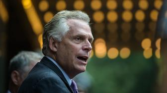 CHARLOTTESVILLE, VA - AUGUST 16: Virginia governor Terry McAuliffe speaks to reporters outside the Paramount Theater after funeral service for Heather Heyer on Wednesday, August 116, 2017, in Charlottesville, VA. Heyer was killed after a car rammed into a group of people during a planned United the Right rally last Saturday. (Photo by Salwan Georges/The Washington Post via Getty Images)