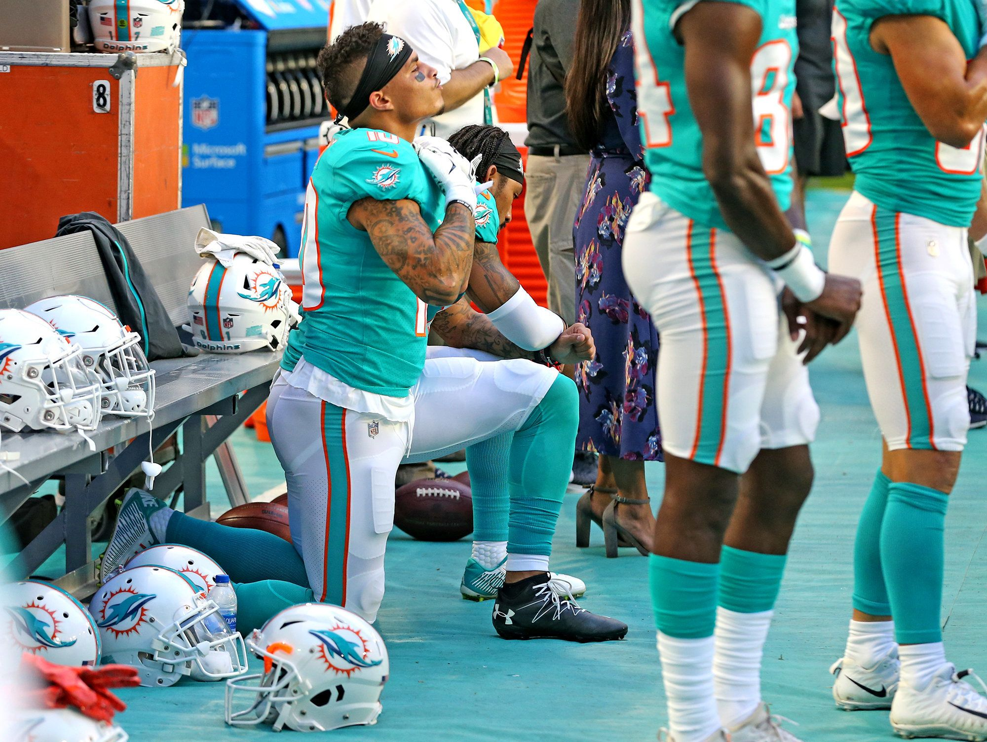 Miami Dolphins receivers Kenny Stills and Albert Wilson kneel during the national anthem as they prepare to play the Tampa Bay Buccaneers at Hard Rock Stadium in Miami Gardens, Fla., on Thursday, Aug. 9, 2018. The Bucs won, 26-24. (Charles Trainor Jr./Miami Herald/TNS via Getty Images)
