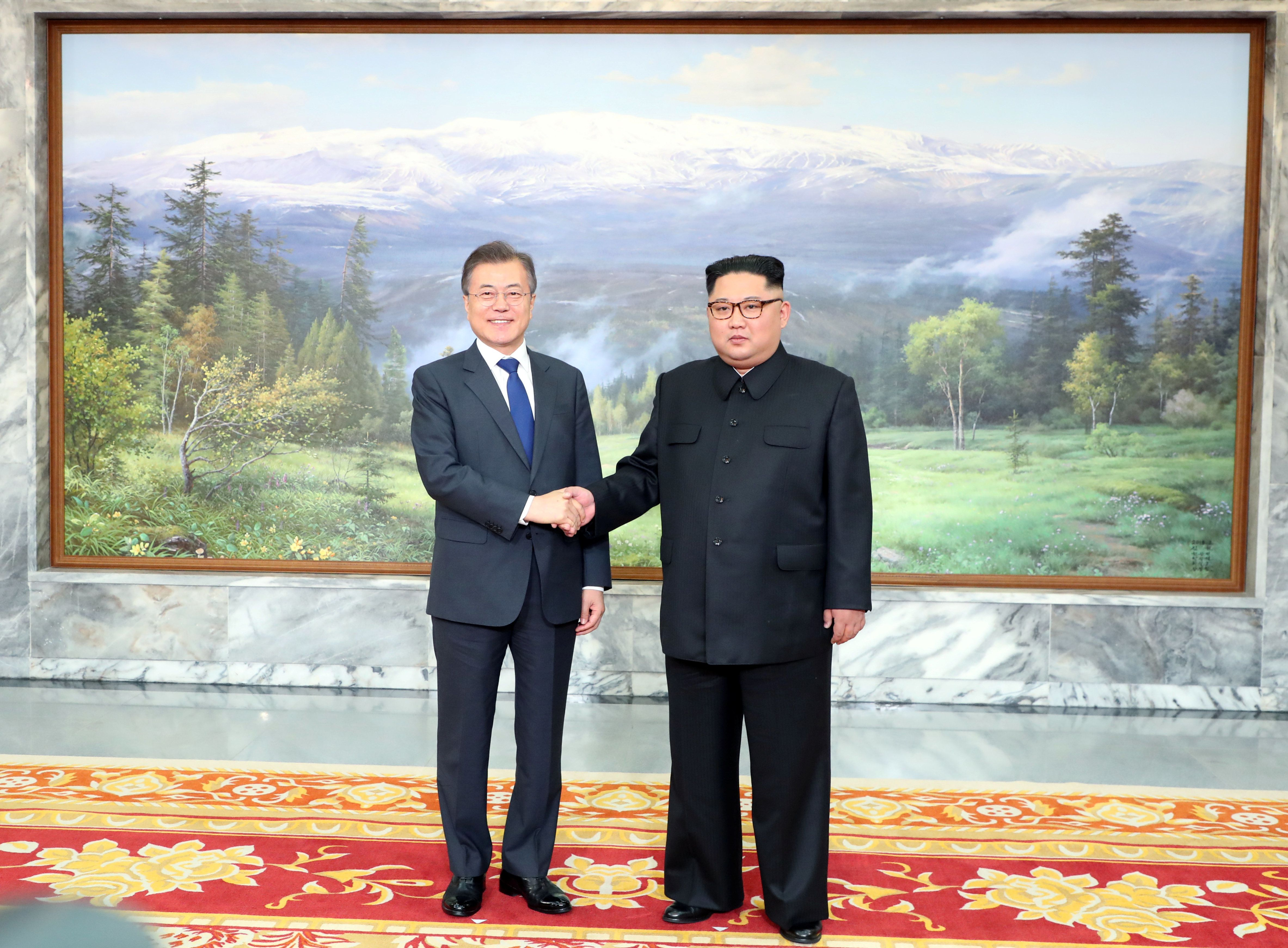 South Korean President Moon Jae-in shakes hands with North Korean leader Kim Jong Un during their summit at the truce village of Panmunjom, North Korea, in this handout picture provided by the Presidential Blue House on May 26, 2018.     The Presidential Blue House /Handout via REUTERS ATTENTION EDITORS - THIS IMAGE WAS PROVIDED BY A THIRD PARTY