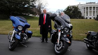 U.S. President Donald Trump and Vice President Mike Pence stands next to Harley Davidson motorcycles after meeting with Harley Davidson executives at the South Lawn of the White House in Washington U.S., February 2, 2017. REUTERS/Carlos Barria