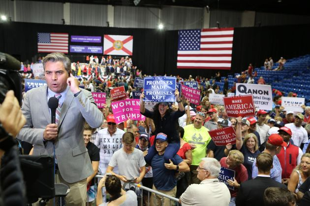 CNN reporter Jim Acosta is heckled by Trump supporters during a Make America Great Again rally in