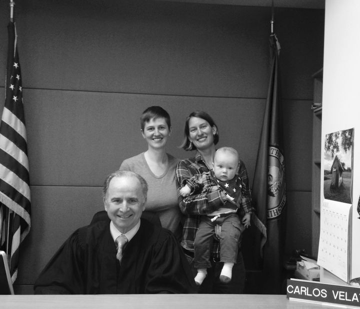 After the adoption hearing. Liegel, Michelle, Finn and the judge who oversaw Liegel's case. King County District Court B